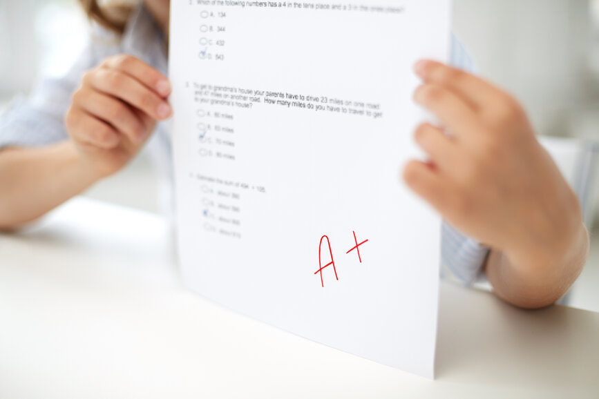 girl with test paper at school