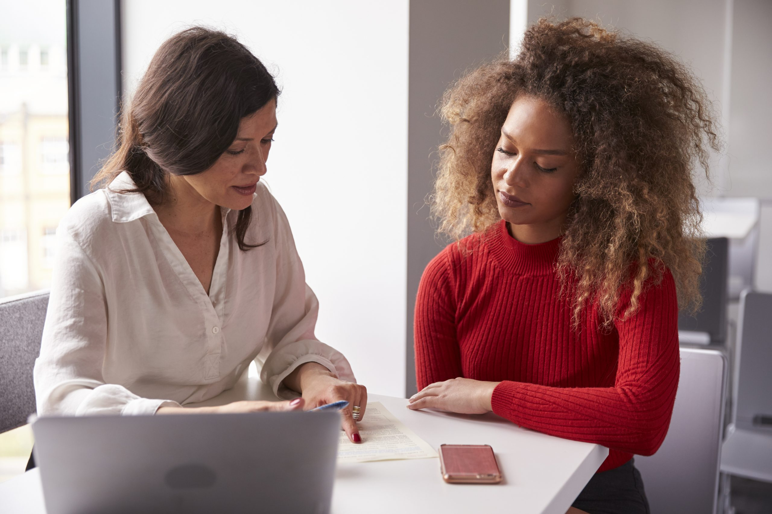 Female University Student Working One To One With Tutor